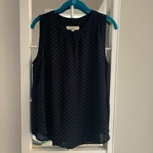 Navy and white polka dotted sleeveless blouse